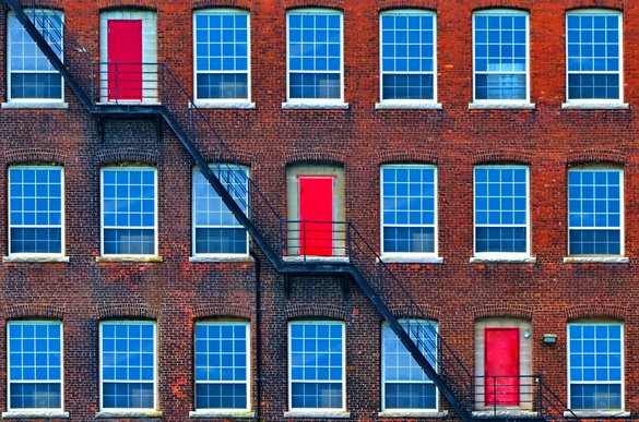 St Catharines blue windows red doors diagonal contrast downtown building rentals rental.jpg