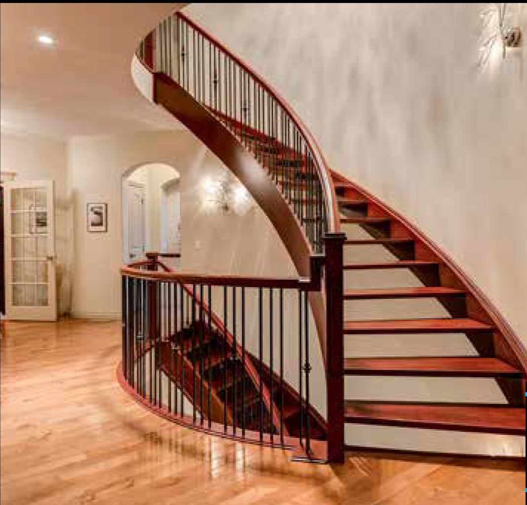 House for rent at 135 Coopers Hill Southwest, Airdrie, AB. This is the stairs with high ceiling and hardwood floor.