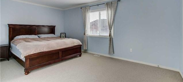 House for rent at 24 Gwillimbury Dr, Bradford West Gwillimbury, ON. This is the bedroom with carpet and natural light.