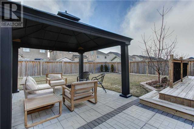 House for rent at 24 Gwillimbury Dr, Bradford West Gwillimbury, ON. This is the patio terrace with outdoor living space, deck and lawn.