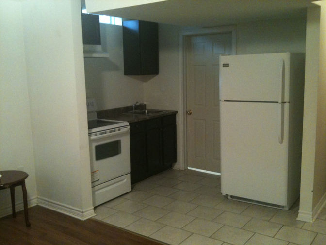 Apartment for rent at 57 Keats Terrace, Brampton, ON. This is the kitchen with hardwood floor and tile floor.