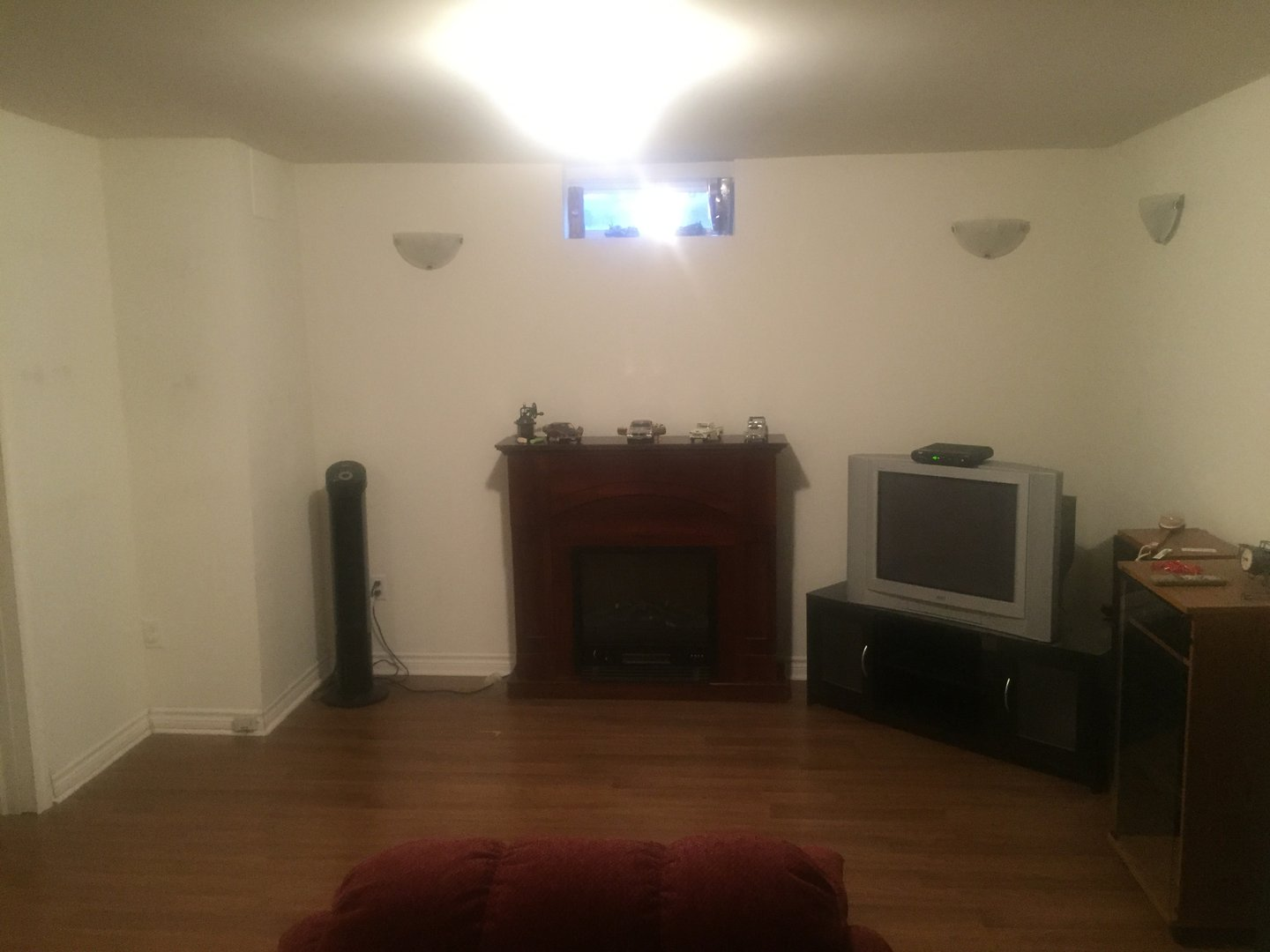 Apartment for rent at 57 Keats Terrace, Brampton, ON. This is the misc room with fireplace and hardwood floor.