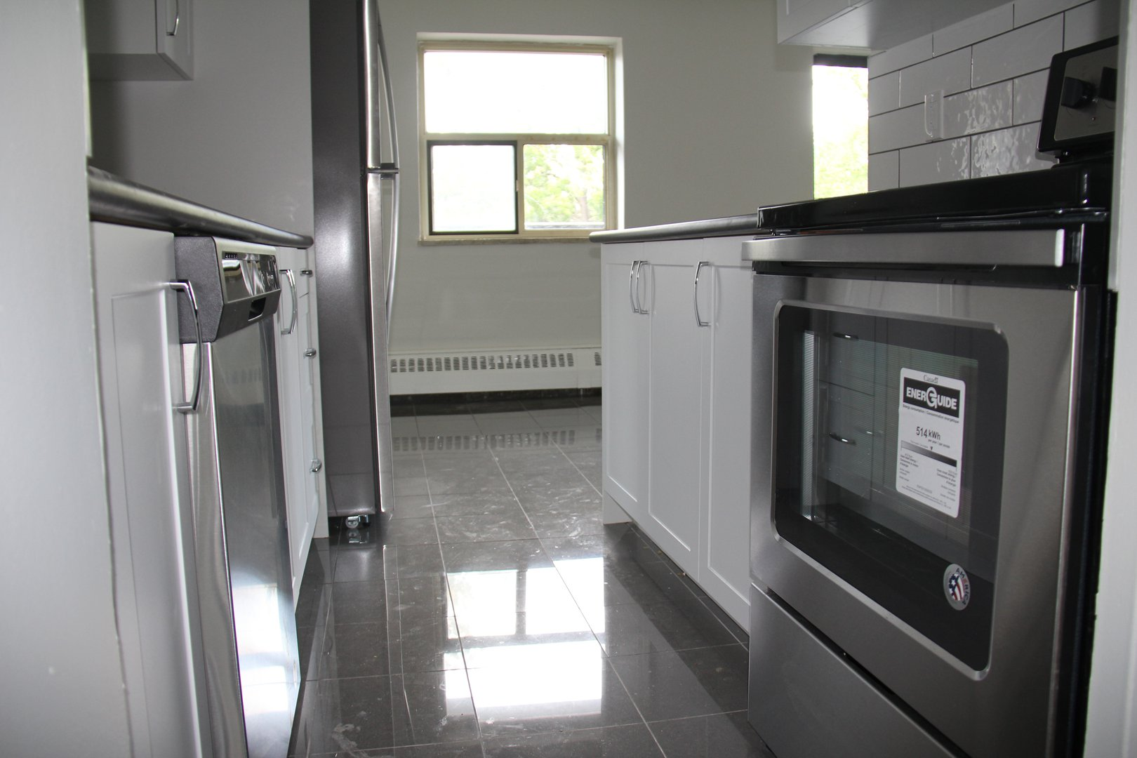 Apartment for rent at 141 Main St S, Brampton, ON. This is the bathroom with natural light, stainless steel and tile floor.