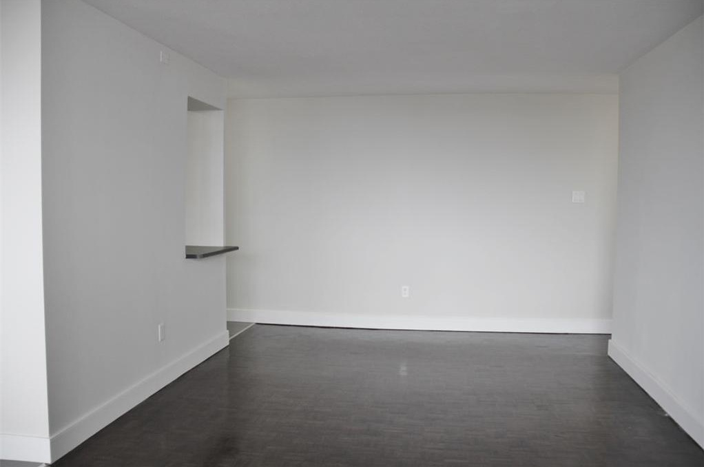Apartment for rent at 141 Main St S, Brampton, ON. This is the empty room with hardwood floor.