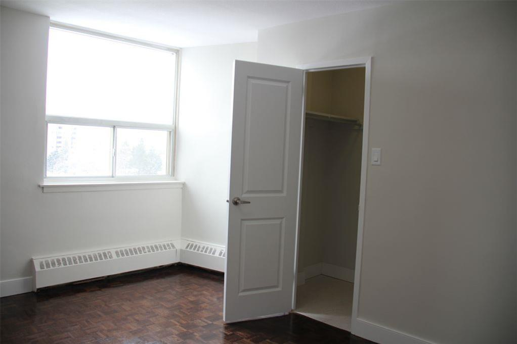 Apartment for rent at 141 Main St S, Brampton, ON. This is the empty room with natural light and tile floor.