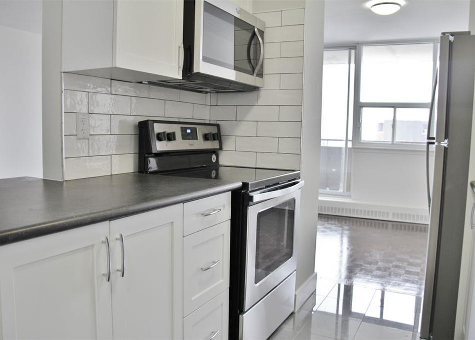 Apartment for rent at 141 Main St S, Brampton, ON. This is the kitchen with natural light, stainless steel and hardwood floor.