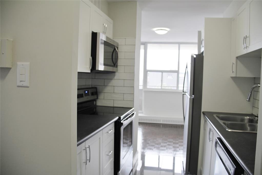 Apartment for rent at 141 Main St S, Brampton, ON. This is the kitchen with natural light and stainless steel.