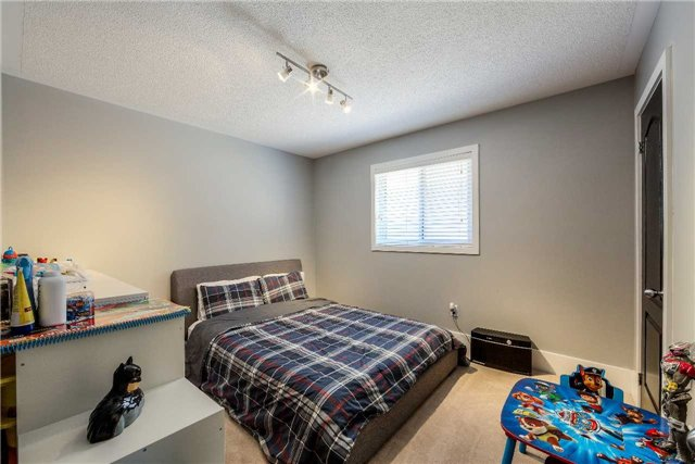 House for rent at 118 Earlsbridge Blvd, Brampton, ON. This is the bedroom with natural light and carpet.