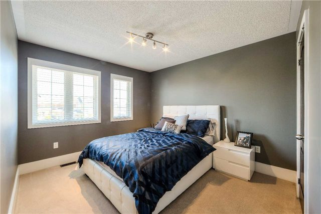 House for rent at 118 Earlsbridge Blvd, Brampton, ON. This is the bedroom with carpet and natural light.
