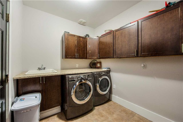 House for rent at 118 Earlsbridge Blvd, Brampton, ON. This is the laundry room with tile floor.
