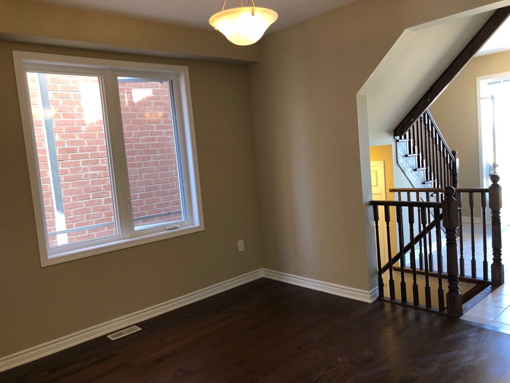 House for rent at 11000 Mississauga Rd | Unit: 66, Brampton, ON. This is the empty room with natural light, tile floor and hardwood floor.