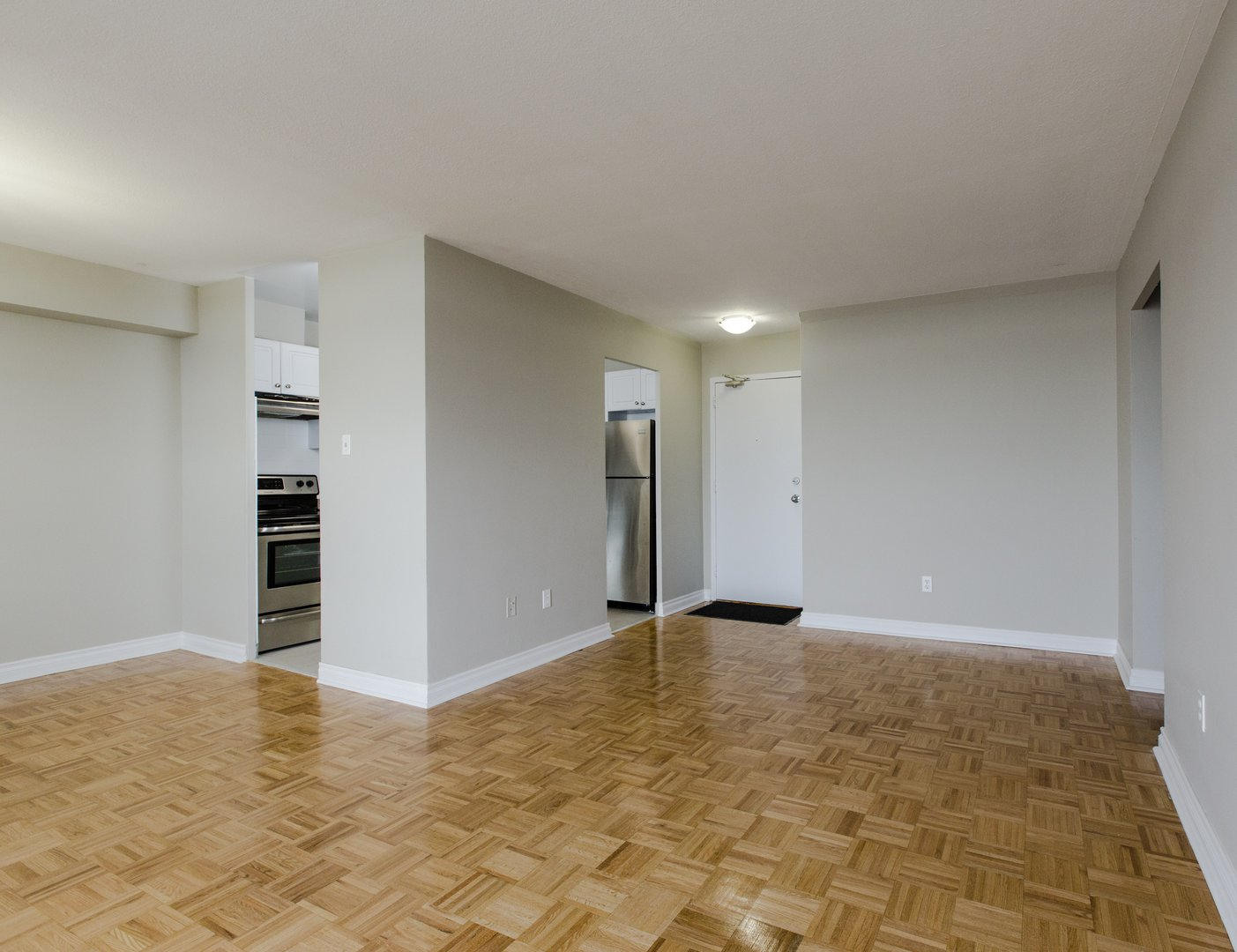 Apartment for rent at 33 Kennedy Rd S, Brampton, ON. This is the empty room with stainless steel and hardwood floor.