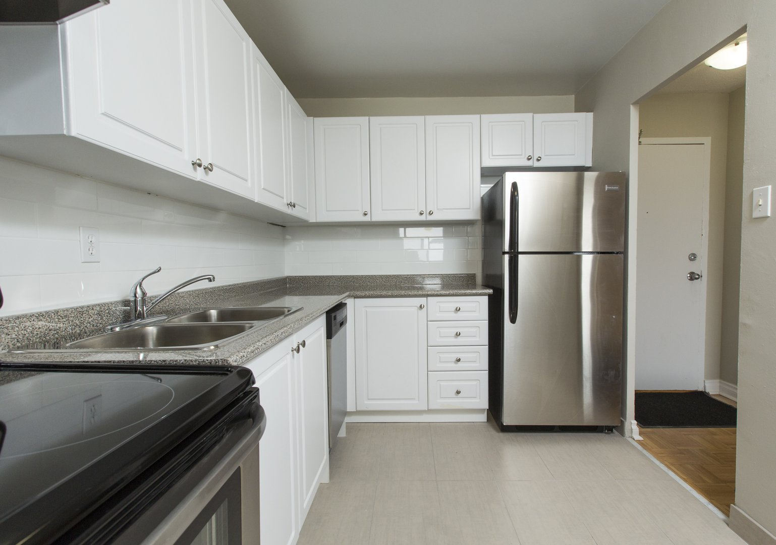 Apartment for rent at 33 Kennedy Rd S, Brampton, ON. This is the kitchen with hardwood floor, stainless steel and tile floor.