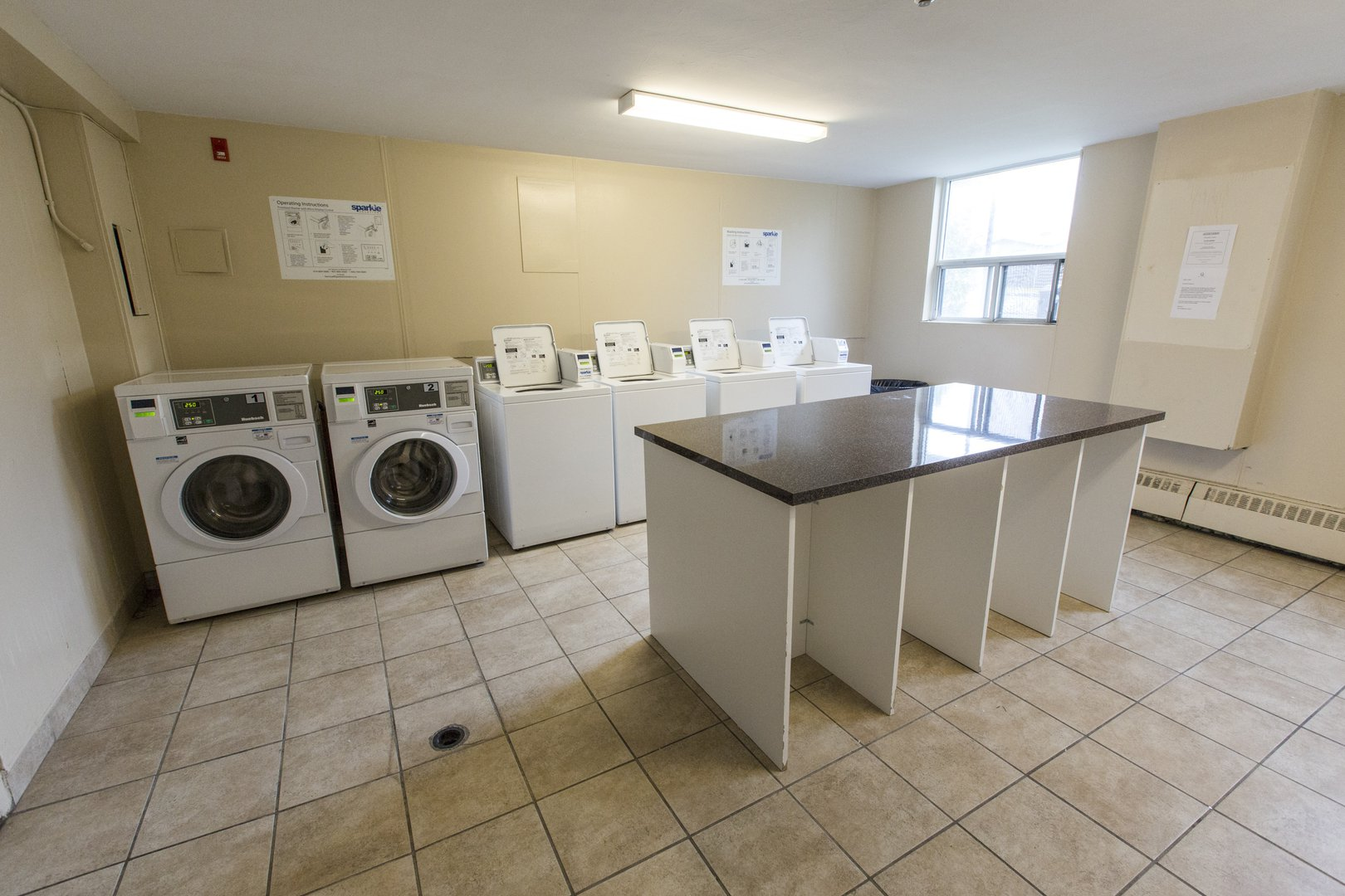 Apartment for rent at 33 Kennedy Rd S, Brampton, ON. This is the laundry room with natural light and tile floor.