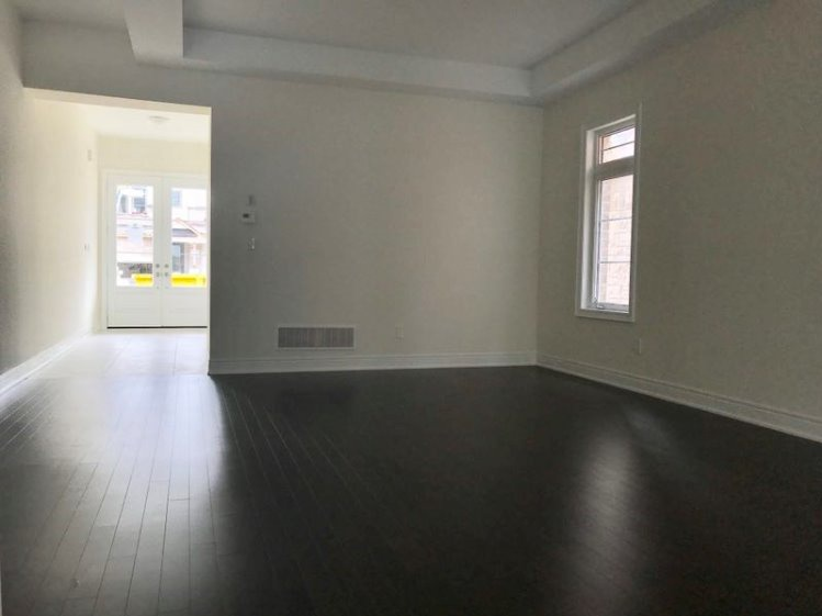 House for rent at 333 Rivermont Road, Brampton, ON. This is the empty room with natural light and hardwood floor.