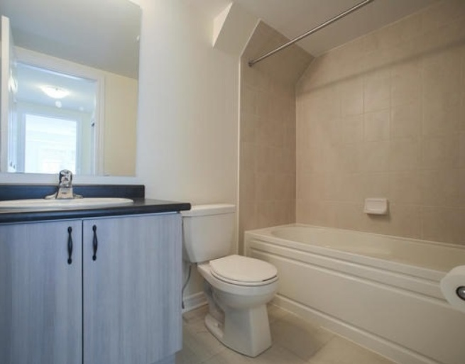 House for rent at 200 Veterans Drive, Brampton, ON. This is the bathroom with natural light and tile floor.