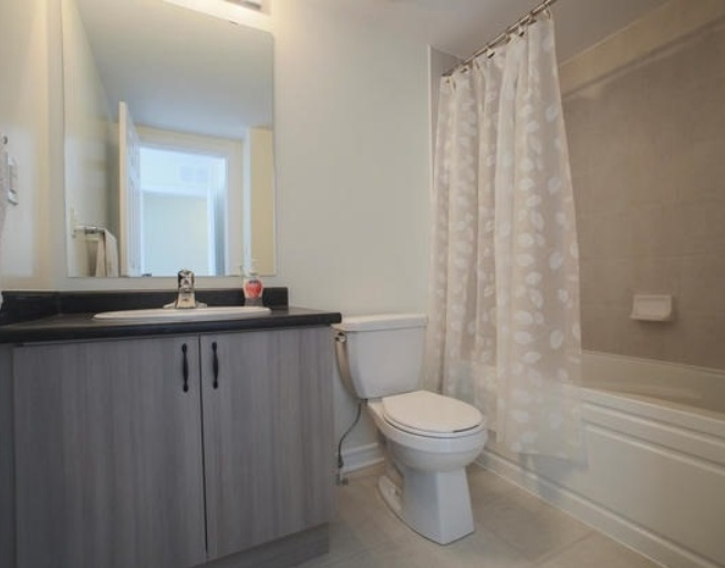 House for rent at 200 Veterans Drive, Brampton, ON. This is the bathroom with tile floor.