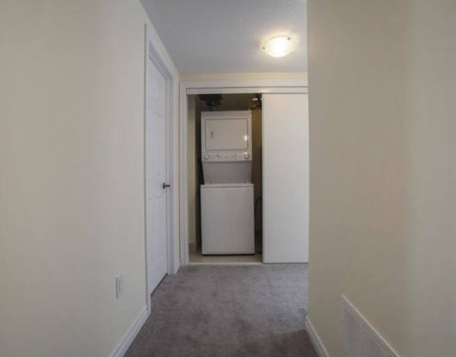 House for rent at 200 Veterans Drive, Brampton, ON. This is the corridor with carpet.