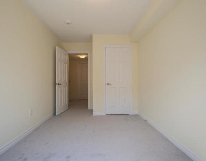 House for rent at 200 Veterans Drive, Brampton, ON. This is the empty room with carpet.