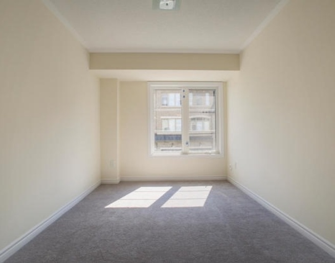 House for rent at 200 Veterans Drive, Brampton, ON. This is the empty room with carpet and natural light.