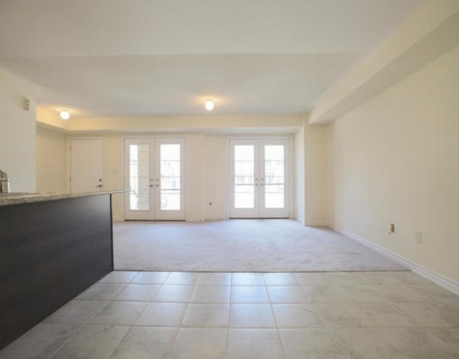 House for rent at 200 Veterans Drive, Brampton, ON. This is the empty room with carpet, natural light and tile floor.