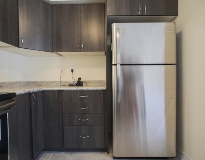 House for rent at 200 Veterans Drive, Brampton, ON. This is the kitchen with stainless steel and tile floor.