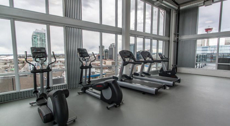 Condo for rent at 450 8 Ave SE, Calgary, AB. This is the gym with natural light and ceiling fan.