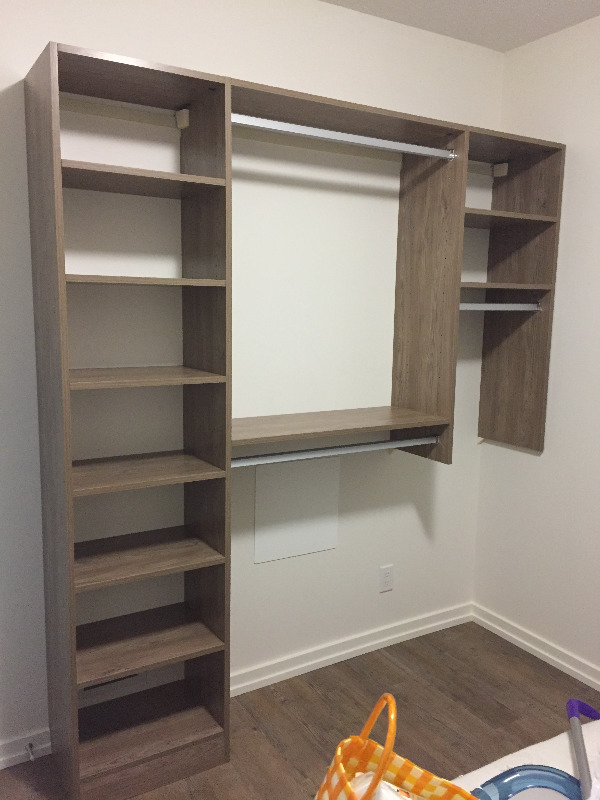 Condo for rent at 450 8 Ave SE, Calgary, AB. This is the walk in closet pantry with hardwood floor.