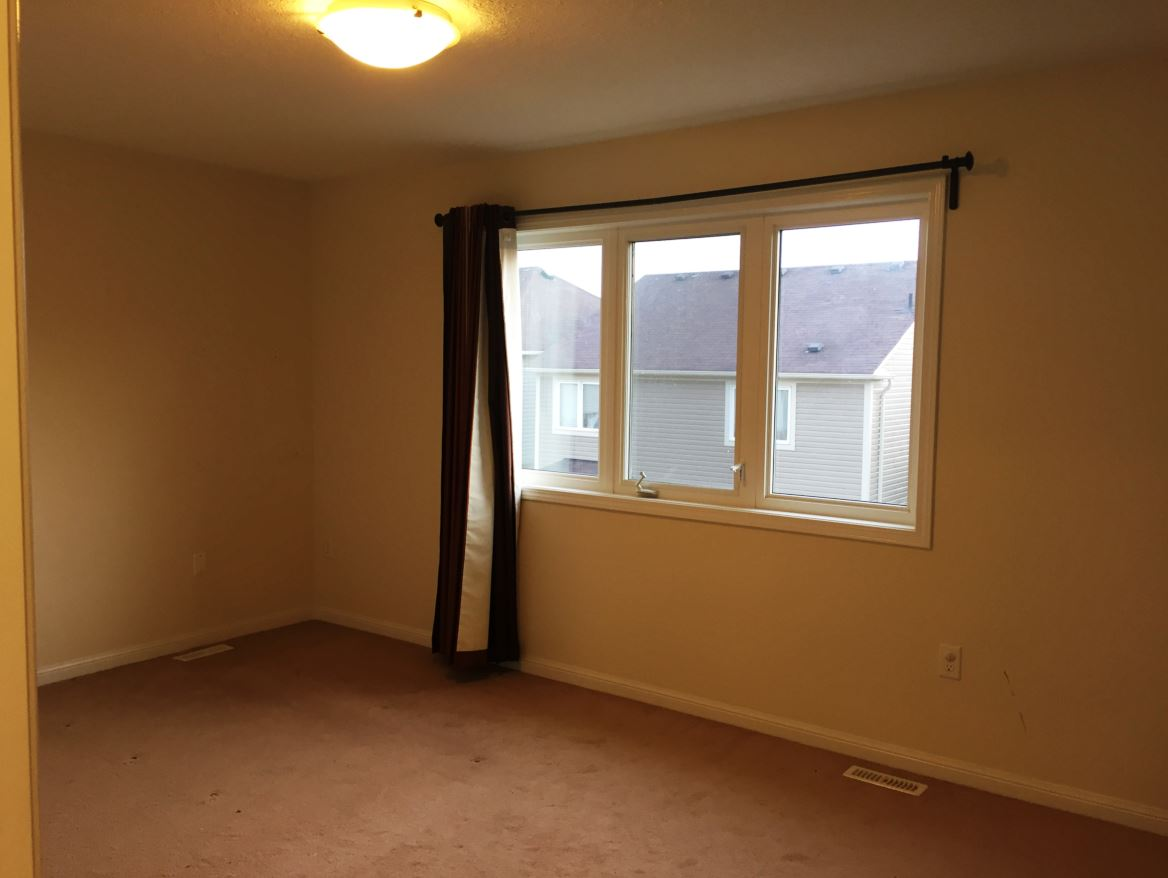 Apartment for rent at 150 Holland Cricle, Cambridge, ON. This is the empty room with natural light and carpet.