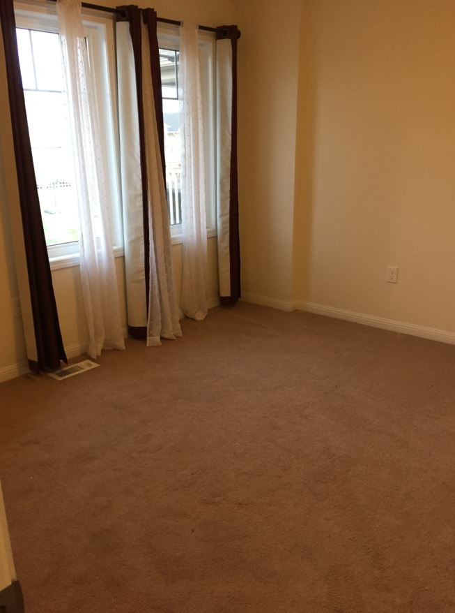Apartment for rent at 150 Holland Cricle, Cambridge, ON. This is the empty room with carpet and natural light.