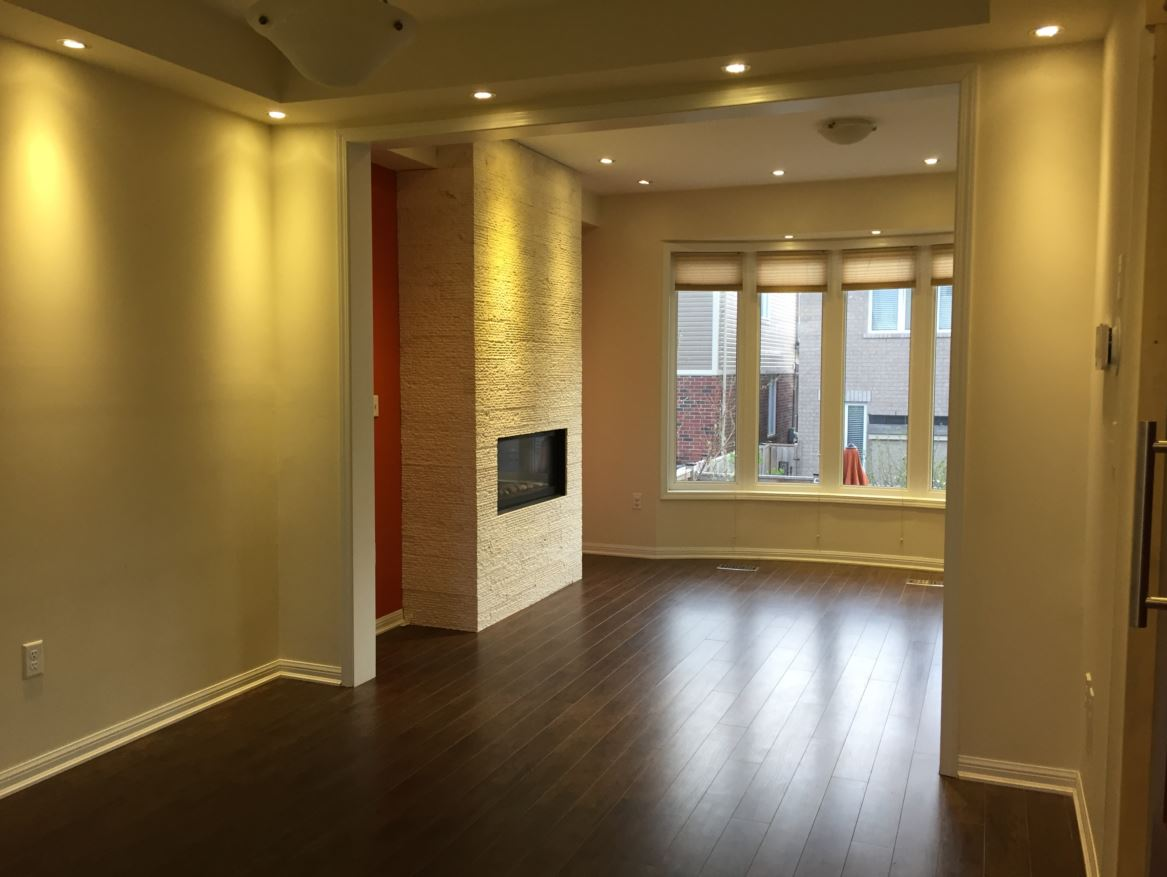 Apartment for rent at 150 Holland Cricle, Cambridge, ON. This is the empty room with natural light, fireplace and hardwood floor.