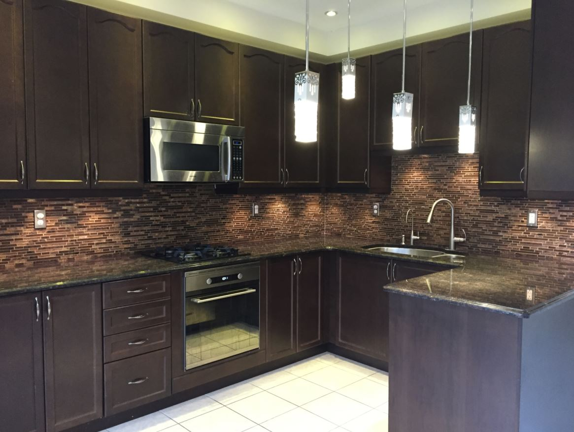 Apartment for rent at 150 Holland Cricle, Cambridge, ON. This is the kitchen with stainless steel and tile floor.