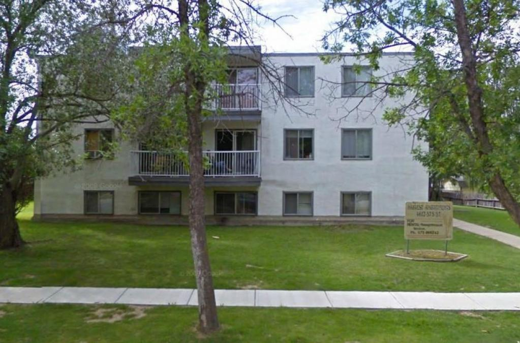 Apartment for rent at 4612 57 Street, Camrose, AB in contemporary style. This is the front of the house with lawn.