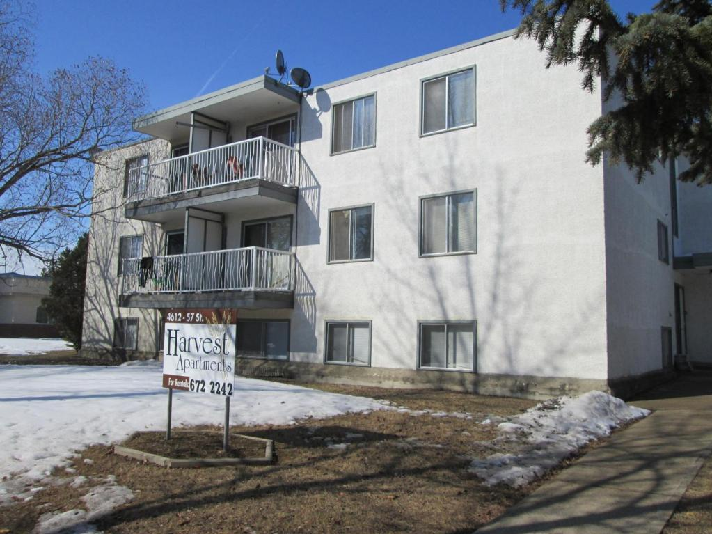 Apartment for rent at 4612 57 Street, Camrose, AB. This is the outdoor building with lawn.