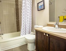 Apartment for rent at 5765 Sir Walter Scott Ave, Côte-Saint-Luc, QC. This is the bathroom with tile floor.