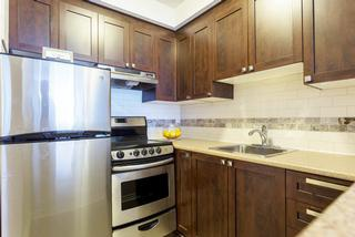 Apartment for rent at 5765 Sir Walter Scott Ave, Côte-Saint-Luc, QC. This is the kitchen with stainless steel.