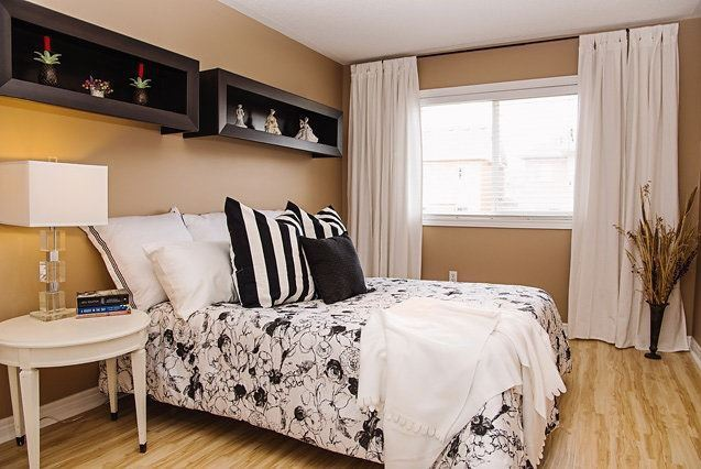 House for rent at 96 Aylesworth Ave, Courtice, ON. This is the bedroom with hardwood floor and natural light.