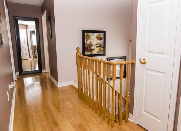 House for rent at 96 Aylesworth Ave, Courtice, ON. This is the corridor with hardwood floor.