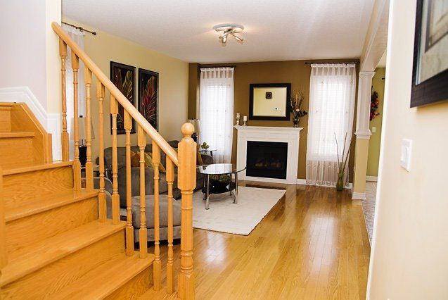 House for rent at 96 Aylesworth Ave, Courtice, ON. This is the foyer entrance with hardwood floor, fireplace and natural light.