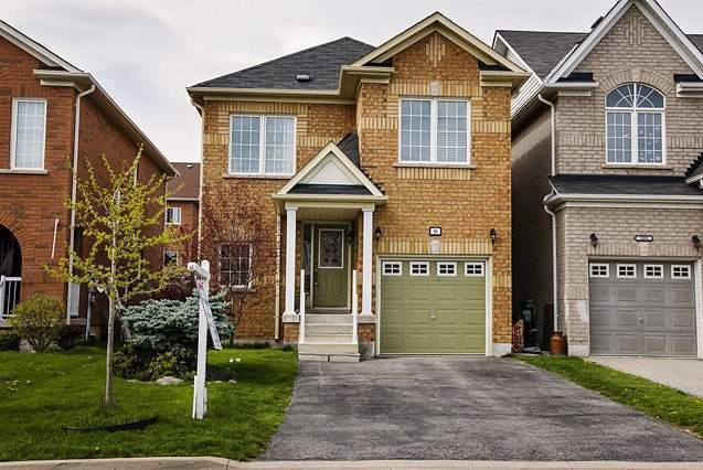 House for rent at 96 Aylesworth Ave, Courtice, ON in craftsman style. This is the front of the house with lawn.