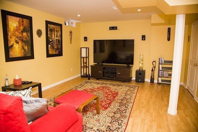 House for rent at 96 Aylesworth Ave, Courtice, ON. This is the living room with hardwood floor.