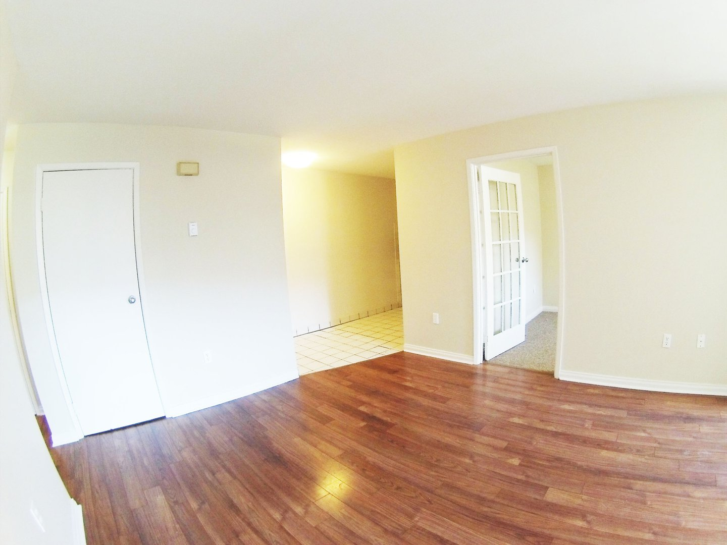 Apartment for rent at 96 Highfield Park Drive B, Dartmouth, NS. This is the empty room with hardwood floor.