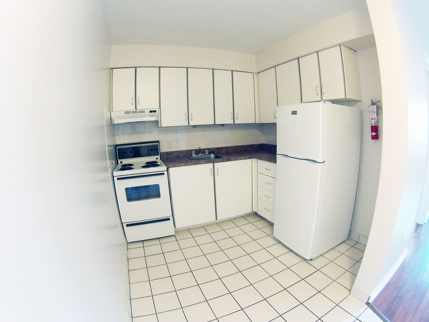 Apartment for rent at 96 Highfield Park Drive B, Dartmouth, NS. This is the kitchen with tile floor.