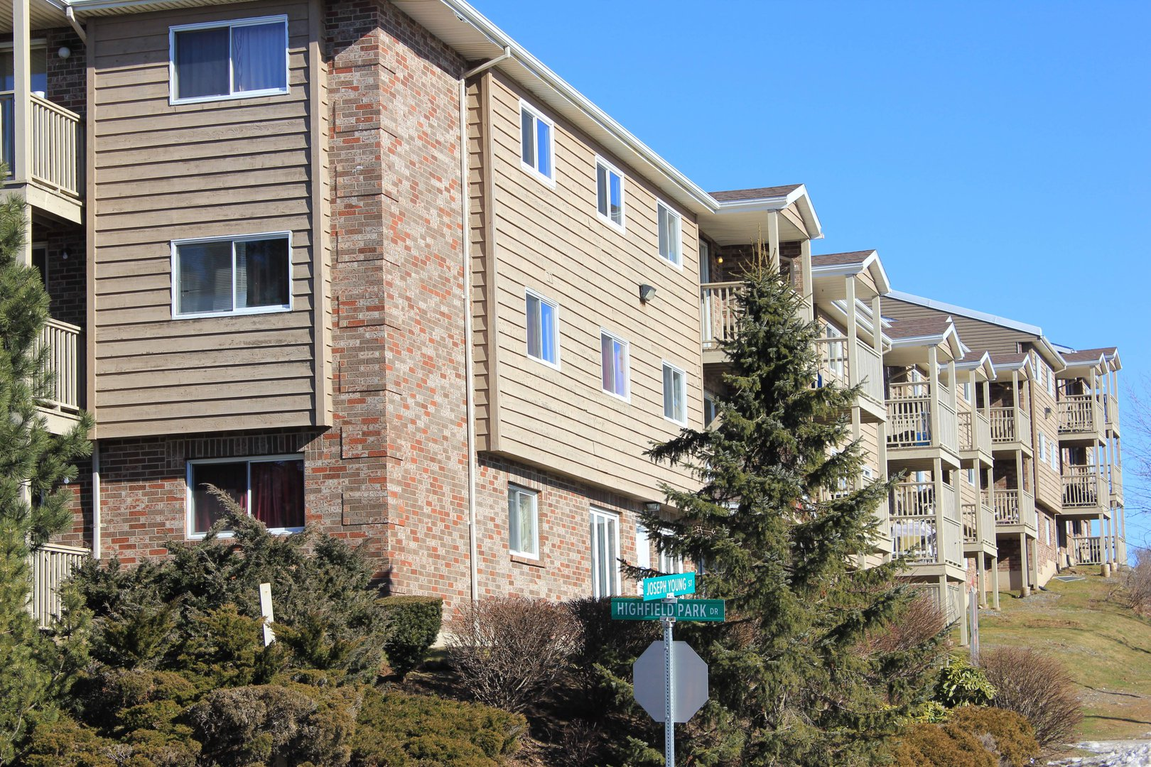 Apartment for rent at 96 Highfield Park Drive B, Dartmouth, NS. This is the outdoor building with lawn.
