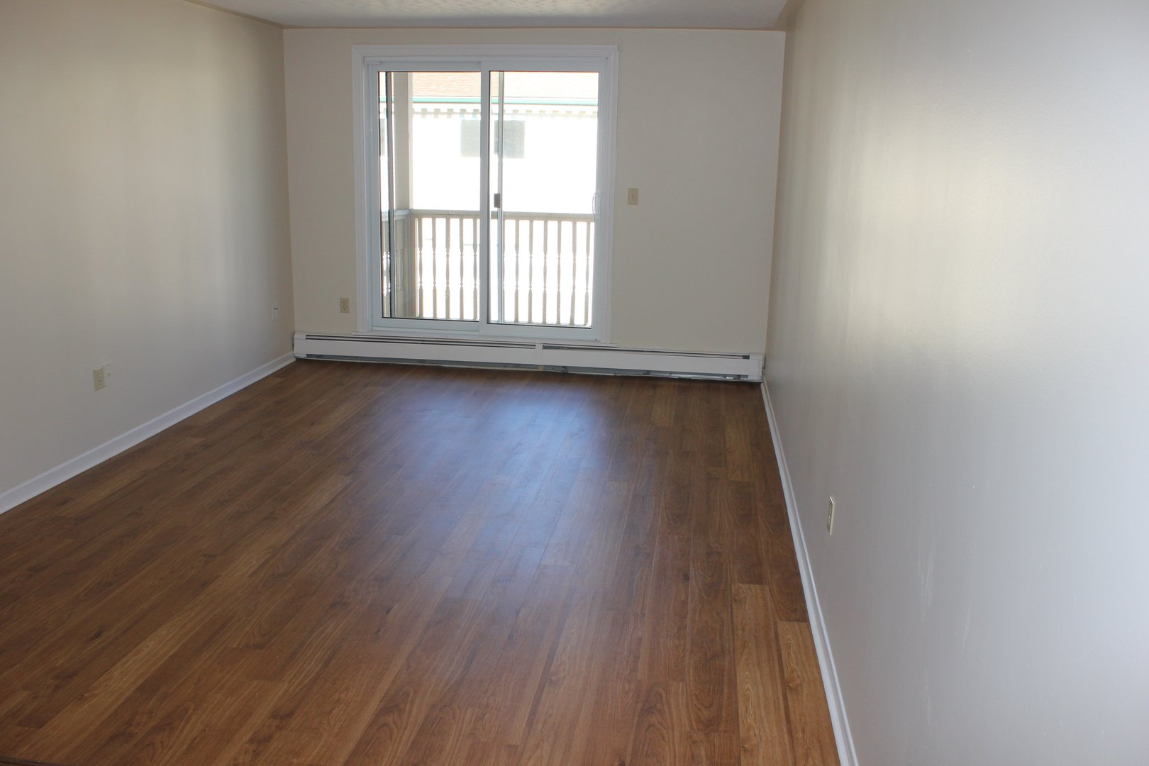 Apartment for rent at 96 Highfield Park Drive G, Dartmouth, NS. This is the empty room with hardwood floor and natural light.