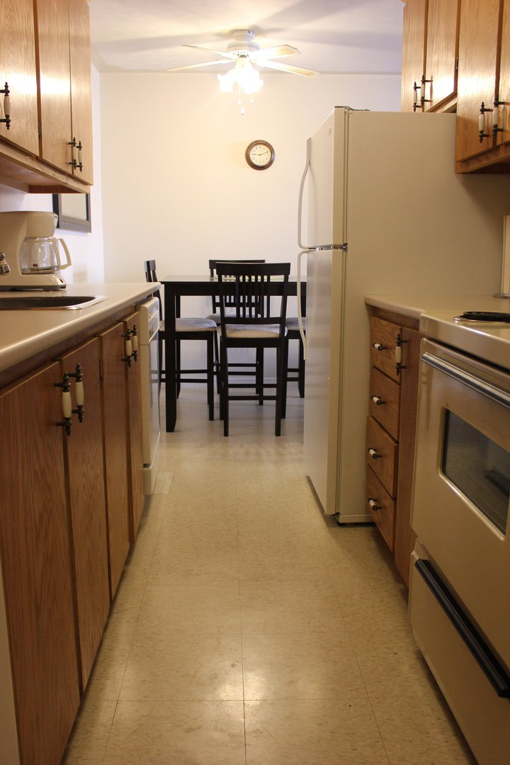 Apartment for rent at 96 Highfield Park Drive G, Dartmouth, NS. This is the kitchen with tile floor and ceiling fan.