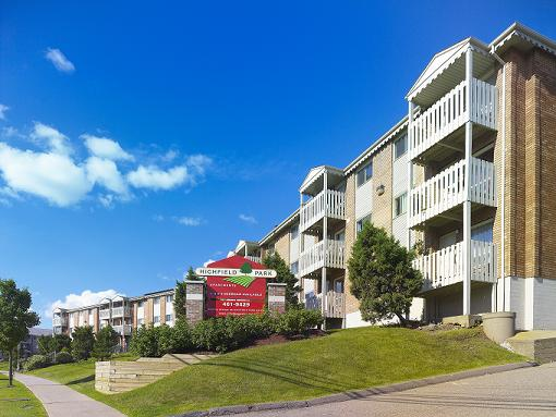 Apartment for rent at 96 Highfield Park Drive G, Dartmouth, NS. This is the outdoor building with lawn.
