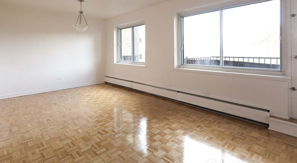 Not Sure for rent at 455 Racine Avenue, Dorval, QC. This is the empty room with hardwood floor and natural light.