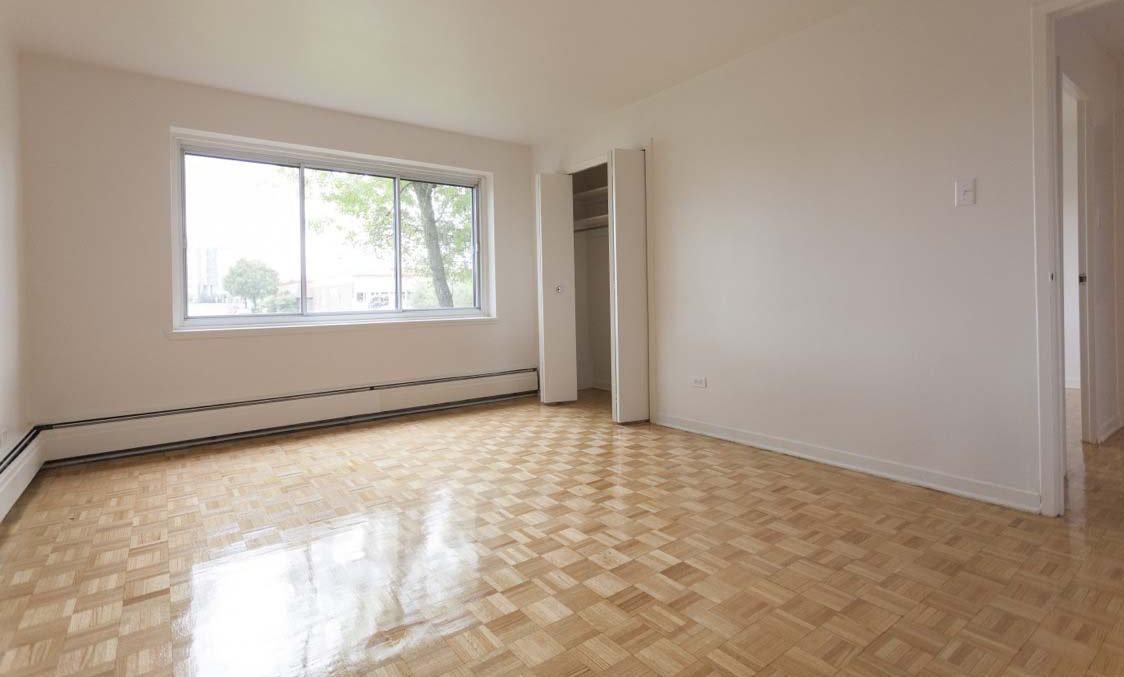 Not Sure for rent at 455 Racine Avenue, Dorval, QC. This is the empty room with tile floor and natural light.