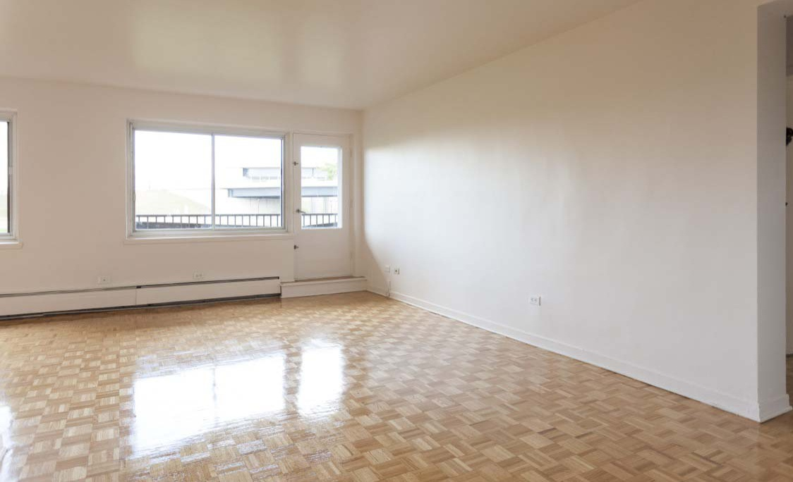 Not Sure for rent at 455 Racine Avenue, Dorval, QC. This is the empty room with vaulted ceiling, tile floor and natural light.